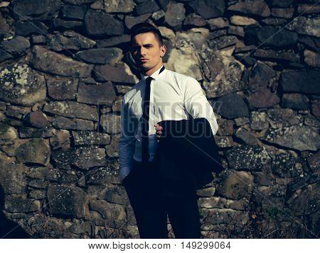 Handsome Man Holds Suit Coat
