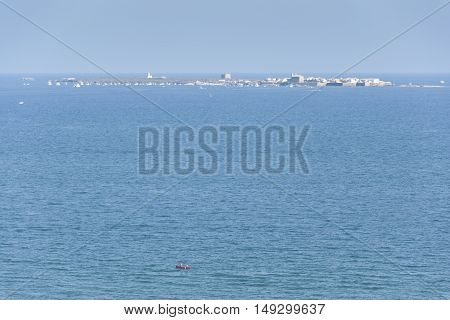Views of Tabarca islet from Santa Pola town Alicante Spain. It is the smallest permanently inhabited islet in Spain.