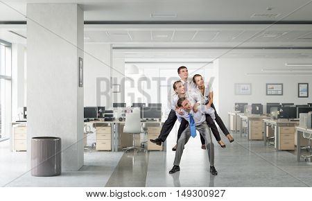 Businesspeople having fun . Mixed media