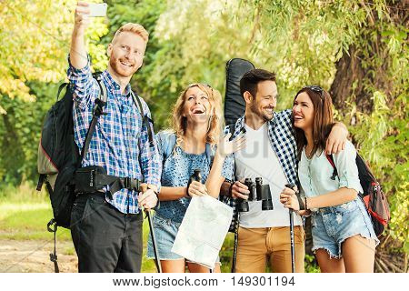 Group of friends are going on camping.They are making selfie on a break.