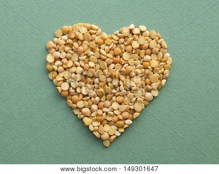 Heart shape made from dry orange peas