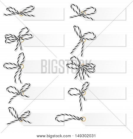 Set of tag labels with black rope bakers twine bows on white background
