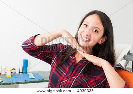 Young Lady Posing With Perfect Smile In Dentist Chair
