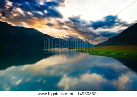 Reflections Of Clouds In Mountain Lake