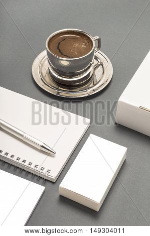 Blank stationery set : coffee cup business cards booklet sheets notebook CD boxes and pencil.