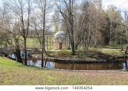 St. Petersburg, Russia - 3 May, A small building at the turn of the river,3 May, 2016. People and spring landscape in Pavlovsk park.