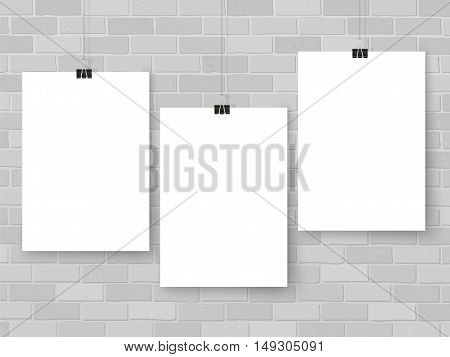 Posters template on grey brick wall. Realistic wall gallery vector illustration. Set of colorful empty vector mockups for your illustrations drawings posters or photos.