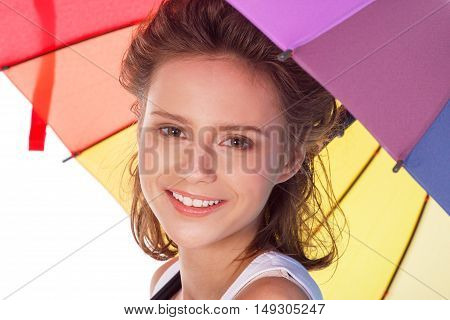 Smiling Young Brunette Woman In White Blouse With Colour Umbrella