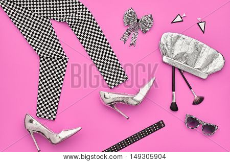Fashion woman Clothes Accessories Set. Fashion Design Outfit. Essentials fashion Cosmetic Makeup. Stylish Leggings, Glamor fashion Heels, Handbag Clutch, Trendy Sunglasses. Top view. Creative. Minimal