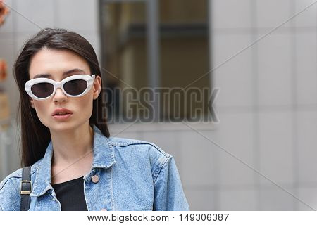 woman in glasses  standing outdoors with copy space