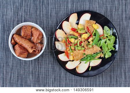 Chinese Vegetable festival  food as fried ginkgo with mixed vegetables served with  fried tofu and fermented flour in brown soup ,