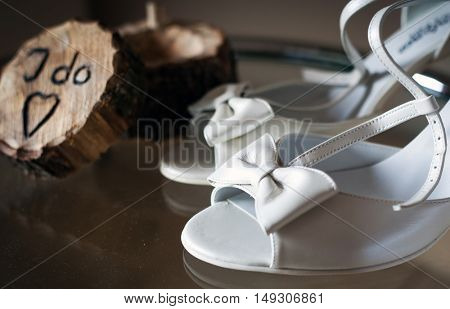 I do written on wooden box and white bridal shoes