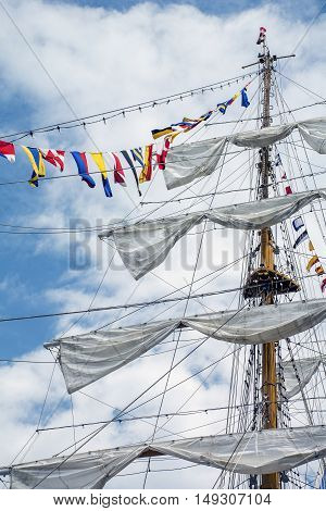 The mast of the ship with flags