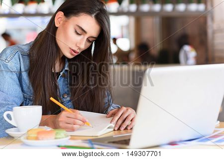 student sketching in her diary in the restaurant