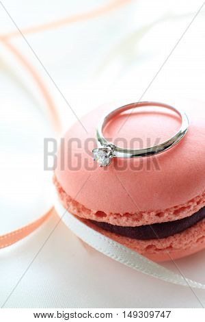 French confectionery, Macaroon and a diamond ring.