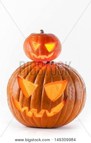 Glowing Halloween pumpkins isolated on white background