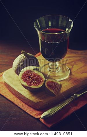 Still life with figs and a glass of red wine