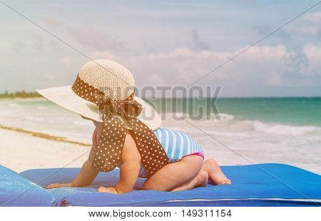 little girl in big hat on summer tropical beach, kids on beach vacation