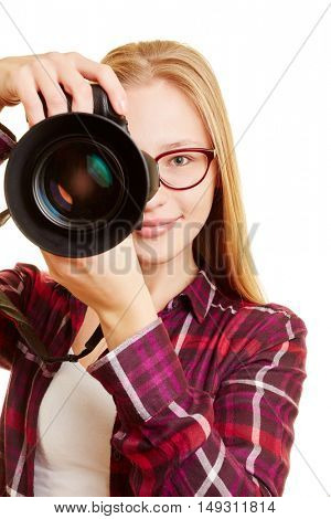 Young woman with digital camera as photographer taking pictures