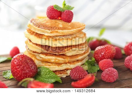 Tasty pancakes with berries and mint, closeup