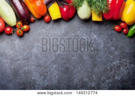 Various vegetables and herbs. Corn, tomatoes, eggplants, bell pepper. Top view with copy space for your recipe
