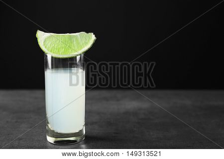 Shot with lime piece on gray table