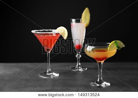Delicious cocktails on gray table