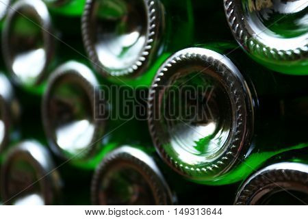 Many wine bottles in cellar, closeup