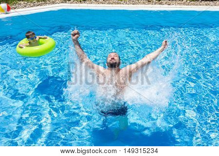 Man jumping up in the pool