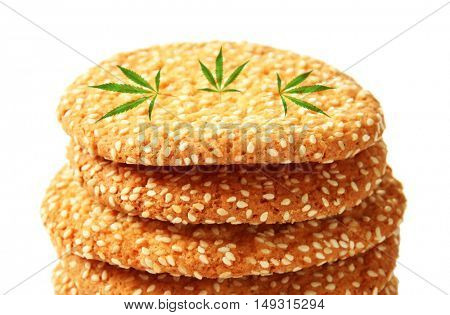 Tasty cookies with marijuana leaves on white background, closeup