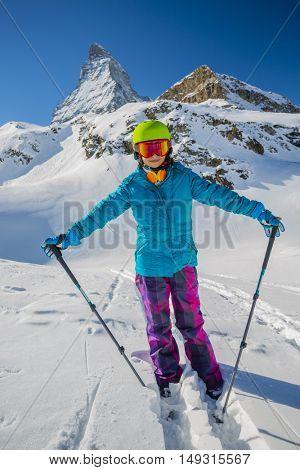 Teenage girl skiing in Swiss Alps in Sunny Day