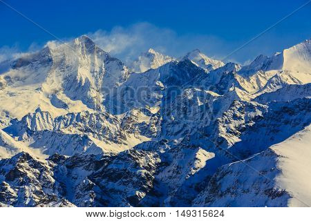Amazing view of swiss famous moutains in beautiful winter snow. The matterhorn and the Dent d'Herens. In the background Castor and Pollux. In the foreground the Grand Desert glacier.