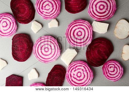 Fresh sliced beetroot on grey background, top view