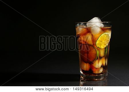 Cuba libre cocktail on dark background