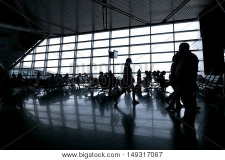 Silhouettes of people in modern airport