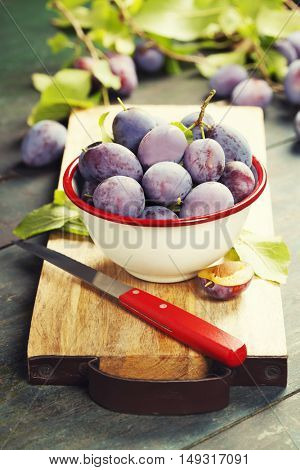 Sweet plums on wooden background.Bio healthy fruits. Selective focus. Copy space background