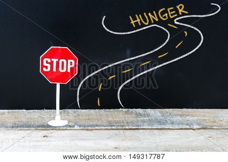 Mini Stop Sign On The Road To Hunger