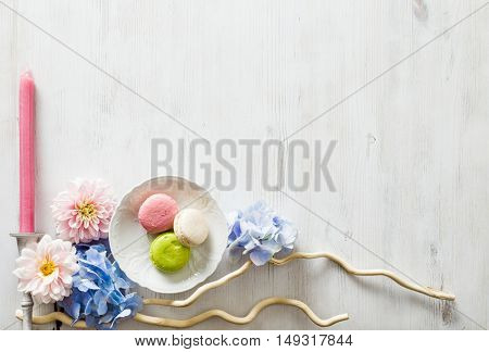 floral decoration with flowers and macaroons