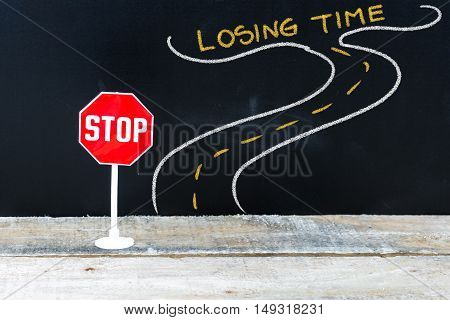 Mini Stop Sign On The Road To Losing Time