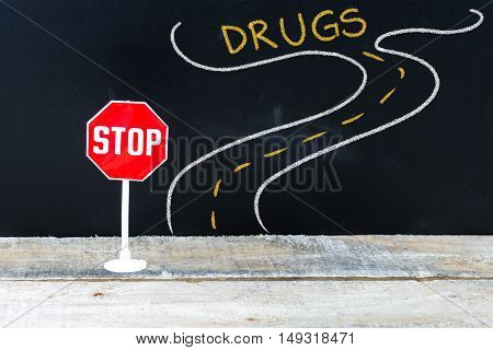 Mini Stop Sign On The Road To Drugs