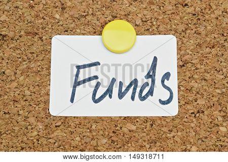 Word Funds written on a sticker pinned on a cork board