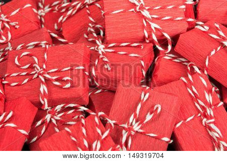 Infinite mountain of red gift boxes with rope