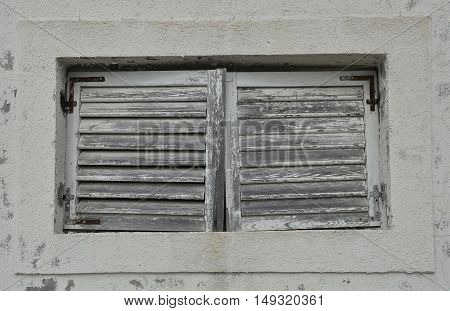 A window in an old building in the historic tiny harbour of Trsteno in Dubrovnik-Neretva County on the Croatian coast.