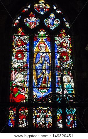Poitiers France - September 12 2016: Very old church Notre Dame la Grande in Poitiers France ornate stained glass window in one of the windows of the church