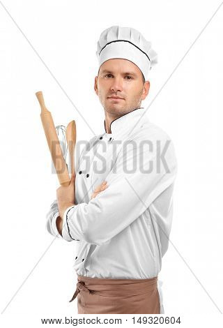 Young chef cook with cutlery isolated on white