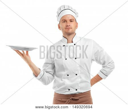 Young chef cook with empty plate isolated on white