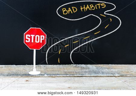 Mini Stop Sign On The Road To Bad Habits