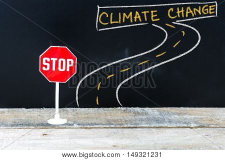 Mini Stop Sign On The Road To Climate Change