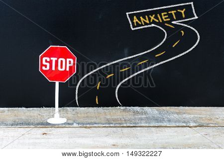 Mini Stop Sign On The Road To Anxiety