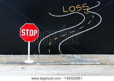 Mini Stop Sign On The Road To Loss